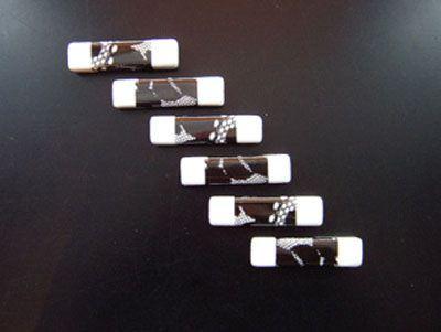 porte couteaux porcelaine n b set de 6. Black Bedroom Furniture Sets. Home Design Ideas